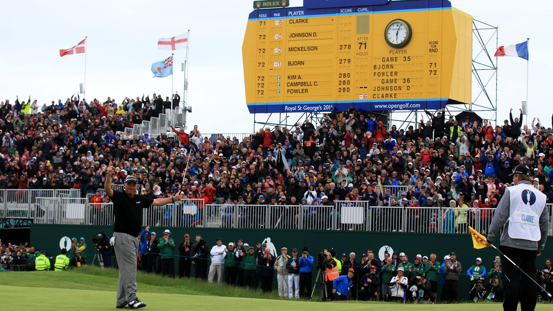 SANDWICH, ENGLAND - JULY 17:   Darren Clarke of Northern Ireland celebrates winning the Open Championship on the 18th green during the final round of The 140th Open Championship at Royal St George's on July 17, 2011 in Sandwich, England. (Photo by David Cannon/R&A/R&A via Getty Images)
